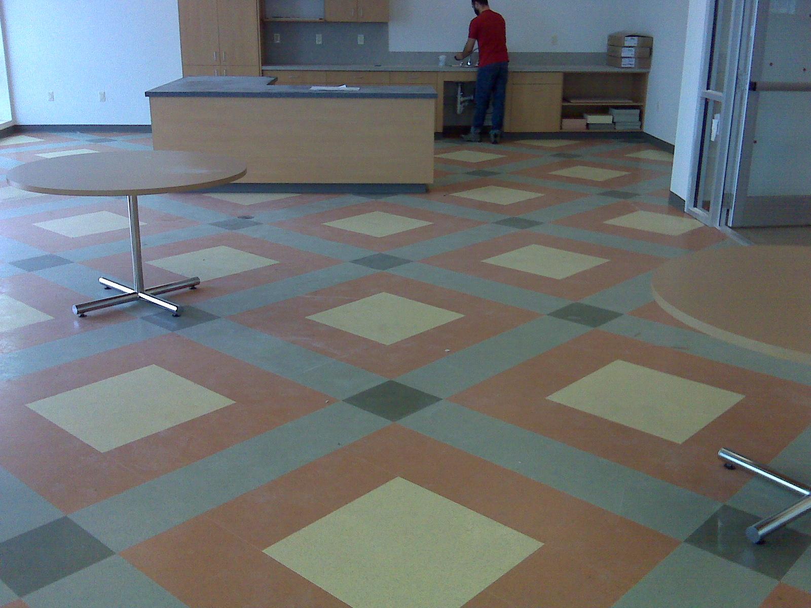 Resilient floor tiles